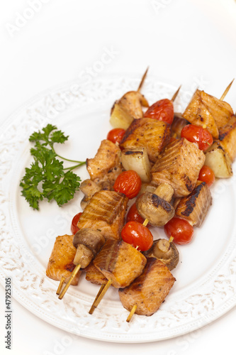 Salmon kebab with tomato and mushrooms