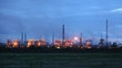 Phosphoric factory in light of lanterns stand against evening