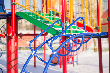 Climbing and crawling constructions on winter playground covered