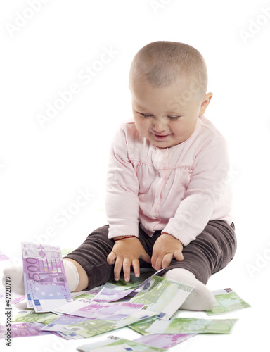 little girl with money on a white background