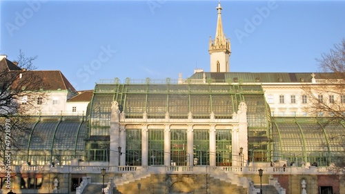 People walk in Palmenhaus which stands in Hofburg Palace park