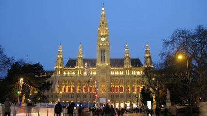 People go for drive on skating rink in front of Rathaus in