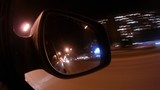 In mirror of automobile reflect of light of night city