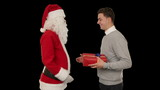 Young Businessman receiving a present from Santa Claus, on black