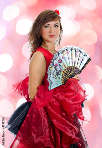 Portrait of attractive flamenco dancer. Bokeh background
