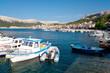 Fisher Boats on port at Baska background Baska old town - Krk -