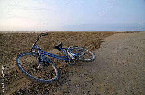 Abandoned bicycle along an empty beach