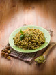 spelt with pesto sauce and hazel nut, vegetarian food