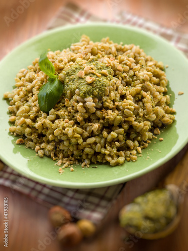 spelt with pesto sauce and hazel nut, selective focus