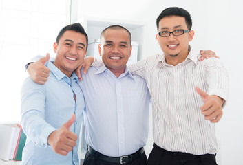 Thumbs up Southeast Asian businessmen