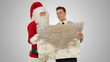 Santa Claus with a Businessman reading a map, against white