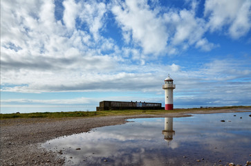 Lighthouse on the shoreline at Millom, Cumbria.