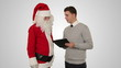 Santa Claus and Young Businessman against white