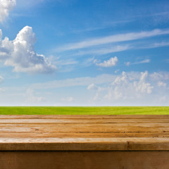 Background with empty wooden table over beautiful medow