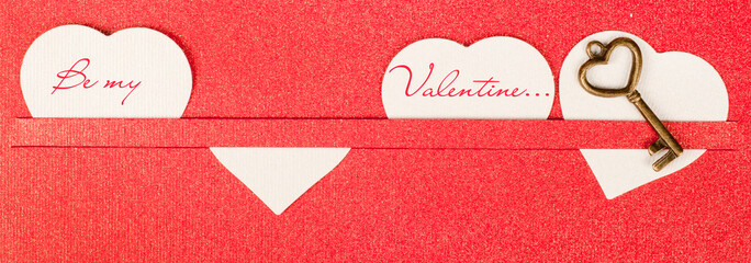 Valentines day card with red hearts and key