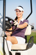 Golfer in golf cart