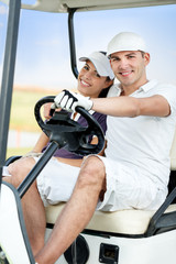 Couple enjoying golf course