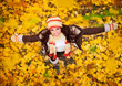 Happy woman playing in autumn
