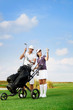 couple playing golf at the club