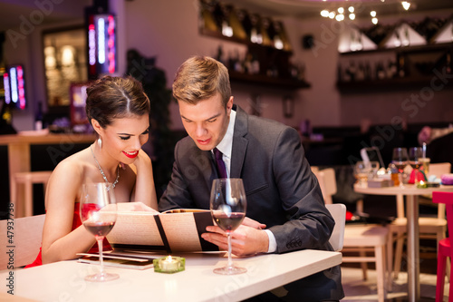 Smiling couple decide what to order