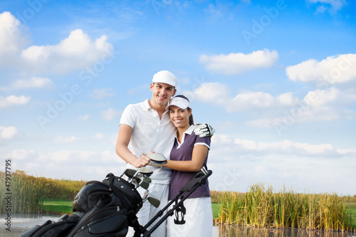 Golf couple with golf bag