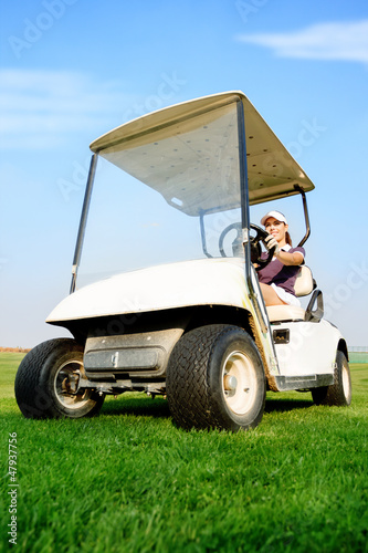 Woman in golf cart
