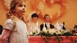 little girl on wedding, behind groom with bride behind table