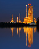 Reflection of gold petrochemical industry on sunset