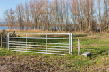 Closed galvanized fence in a rural landscape poster