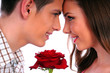 beautiful young couple with red rose