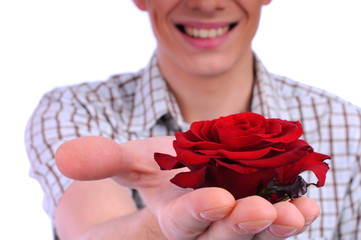 young boy with a flower in your hand