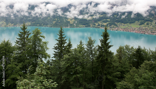 Beautiful turquoise lake Brienz in alpine mist Switzerland