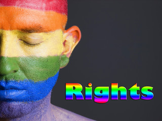 "Gay flag face man, word ""rights"" and closed eyes."