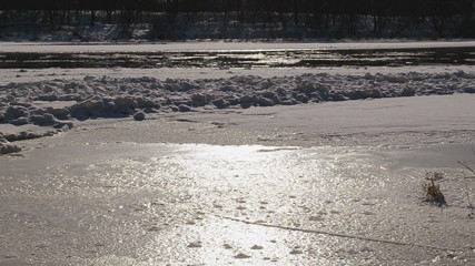 frozen river neris in winter floe floating in water and sunlight