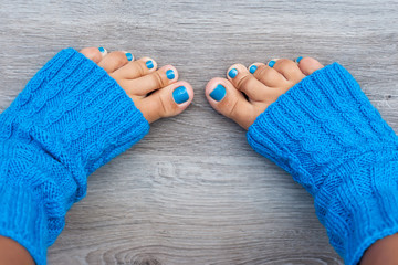 Feet with blue nails manicure