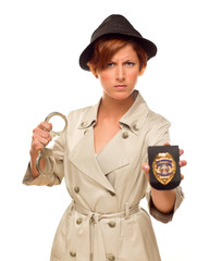 Female Detective With Handcuffs and Badge In Trench Coat