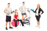 A small group of athletes posing with a fitness equipment poster