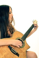 young teenage woman with an acoustic guitar
