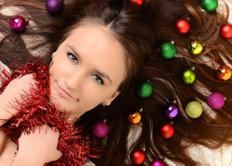 Beautiful woman with christmas decorations