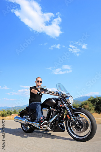 Biker riding a customized motorcycle