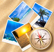 Traveling photos with compass on sand beach