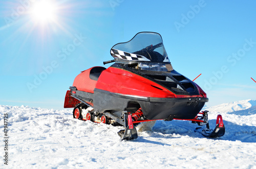 snow mobile ski sun sky blue red mountain