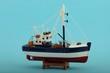 canvas print picture - Fischerboot model mit blauem Hintergrund