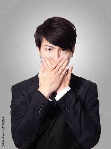 young business man covering his mouth