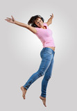 young woman dancing and jumping