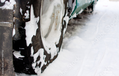 wheel of truck in snow