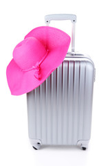 Silver suitcase with woman's hat  isolated on white