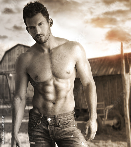 Sepia toned portrait of a hunky male model