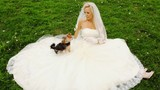 blonde in wedding dress sits on lawn and plays floret with