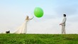 Newly-married couple throws big green sphere